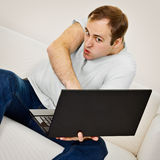 Comic man plays on a laptop Royalty Free Stock Photo