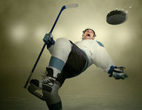 Comic moment of the Ice Hockey game: player dodging puck Royalty Free Stock Photo