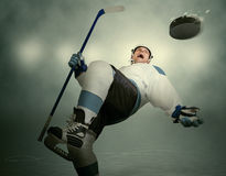 Comic Moment Of The Ice Hockey Game: Player Dodging Puck Royalty Free Stock Image