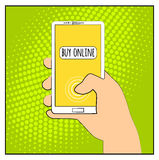 Comic phone with halftone shadows. Hand holding smartphone with buy online internet shopping. Pop art retro style. Flat design. Ve Royalty Free Stock Photo