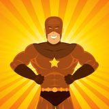 Comic Power Superhero. Illustration of a happy awesome powerful comic superhero with red disguise standing proudly with light explosion and sunbeams behind Royalty Free Stock Photos