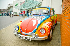 Comic Relief Beetle. SANDOWN PARK, UK - MARCH 26, 2011: Custom graffiti paintwork on a vintage Volkswagen Beetle, used to help raise money for and advertise the Stock Photo