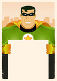 Comic Super Hero Holding Sign. Illustration of a stylized comic green and yellow powerful superhero holding blank advertisement sign with cityscape background Stock Photo