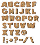 Comic Wood Alphabet. Illustration of a set of wooden comic ABC letters and font characters also containing punctuation symbols Stock Illustration