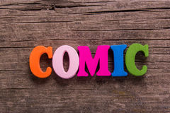 Comic word made of wooden letters Stock Photography