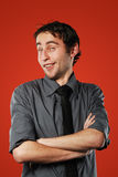 Comic young man on red. Expressive comic conceited young man isolated on red background royalty free stock photos