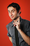 Comic young man on red. Isolated on red background, funny young man has very good idea stock photos