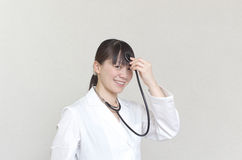 Comical Asian woman doctor Royalty Free Stock Photography
