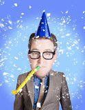 Comical dad celebrating fathers day in party hat. Comical dad in geek glasses celebrating fathers day in birthday party hat with whistle. Dad jokes Royalty Free Stock Photography