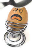 Comical Egg. Funny comical Egg scared with coming Spoon Stock Images