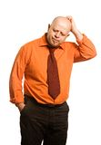 The comical fat man in an orange shirt royalty free stock photos
