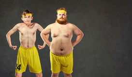 Comical and funny fat and thin athletes.  Royalty Free Stock Image