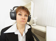 Comical girl in big stereos ear-phones Stock Photos