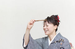 Comical Japanese woman. In a kimono with a hand fan Royalty Free Stock Images