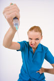 Comical nurse. Funny picture of female hand in medical gloves with syringe Stock Images