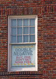 Comical sign in window Royalty Free Stock Photo