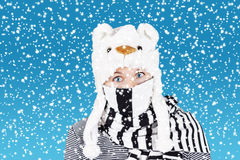 Comical woman and heavy snow. Woman with funny surprised expression wearing winter hat and scarf, heavy snow stock images