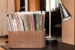 Comics book collection. Different comics boook in basket Royalty Free Stock Photography