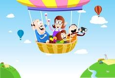 Comida campestre de la familia en el balón de aire Foto de archivo libre de regalías