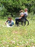 Comida campestre del sillón de ruedas Fotos de archivo libres de regalías