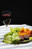 Comida con el vidrio de vino Imagenes de archivo