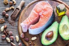 Comida con las grasas Omega-3 imagenes de archivo