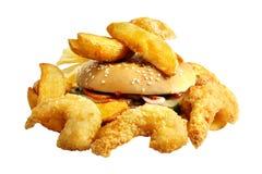 Comida de alimentos de preparación rápida con la patata y la hamburguesa Imagen de archivo