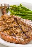 Comida de carne del T-bone imagenes de archivo