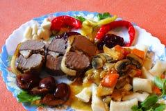 Comida de la carne de venado Fotos de archivo libres de regalías