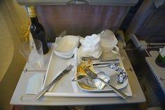 Comida de la línea aérea consumida Fotos de archivo