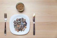Comida de piedra en una tabla Foto de archivo libre de regalías