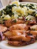 Comida del calamar y de la patata Foto de archivo libre de regalías