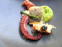 Comida del pulpo fotografía de archivo