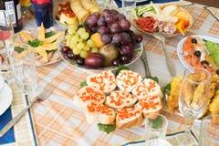 Comida en la tabla del día de fiesta Fotografía de archivo libre de regalías