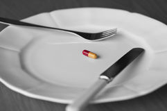 Comida en una píldora Imagen de archivo