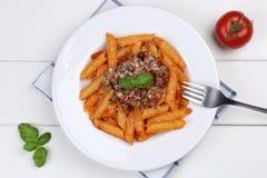 Comida franco de las pastas de los tallarines de la salsa de Penne Rigate Bolognese o de Bolognaise Foto de archivo libre de regalías