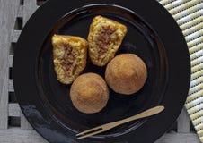 Comida italiana típica: la comida siciliana llamó arancini Fotografía de archivo