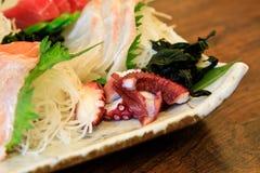 Comida japonesa con el pulpo Imagenes de archivo