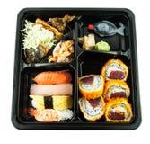 Comida japonesa en una caja o una fiambrera Foto de archivo libre de regalías