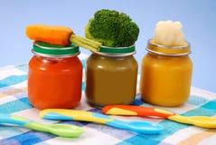 Comida para bebé em uns frascos Imagens de Stock Royalty Free