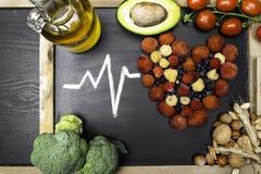 comida para el corazón, ricos con los antioxidantes, ácidos hidroclóricos monounsaturated fotos de archivo