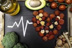 comida para el corazón, ricos con los antioxidantes, ácidos hidroclóricos monounsaturated imagen de archivo