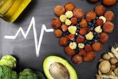 comida para el corazón, ricos con los antioxidantes, ácidos hidroclóricos monounsaturated fotos de archivo libres de regalías