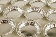 Comida redonda del papel de aluminio aislada Foto de archivo libre de regalías