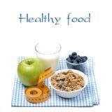 Comida sana - manzana, arándano, agua y muesli, aislados Fotografía de archivo libre de regalías