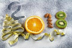 Comida sana y dieta de los días de fiesta Decisiones del ` s del Año Nuevo sobre una forma de vida sana Imágenes de archivo libres de regalías