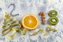 Comida sana y dieta de los días de fiesta Decisiones del ` s del Año Nuevo sobre una forma de vida sana Fotos de archivo