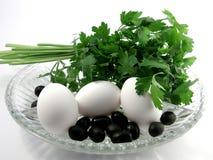 Huevos y persley Foto de archivo libre de regalías