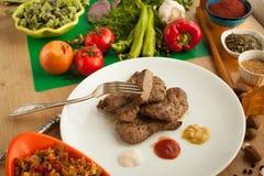 Comida vegetariana contra la carne Imágenes de archivo libres de regalías