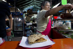 Comida. Woman cooking tortas for hungry workers and travelers in Tepoztlan, Mexico Royalty Free Stock Image
